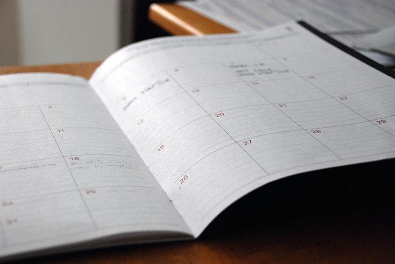 Foto  de uma agenda ilustrando o planejamento do contéudo